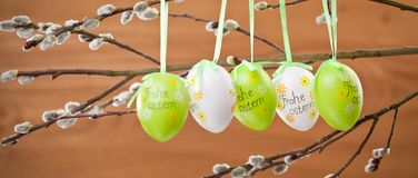 Easter Pussy-willow and Easter egg on wooden background. Happy. Easter card. with Happy Easter text in german stock photos
