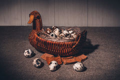 Easter quail eggs. In a basket stock images
