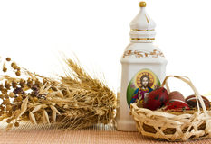 Easter. Quail eggs in the basket and carafe. Quail eggs in the basket, meadow and carafe Stock Image