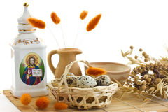 Easter. Quail eggs in the basket,meadow and carafe. Quail eggs in the basket, meadow and carafe Stock Image