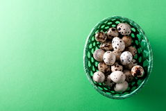Easter quail eggs in a basket, top view Stock Photography