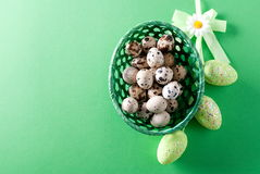 Easter quail eggs in a basket, top view Royalty Free Stock Photos