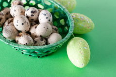 Easter quail eggs in a basket, top view Royalty Free Stock Photography