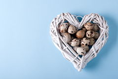 Easter quail eggs in a basket, top view Stock Images