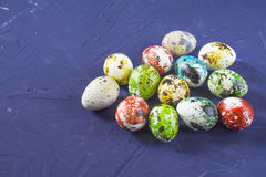 Easter quail eggs. On blue background Stock Photos