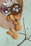 Easter quail eggs and cookies Stock Photography