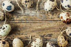 Easter - quail eggs with hay on an old vintage wood from above Stock Photo