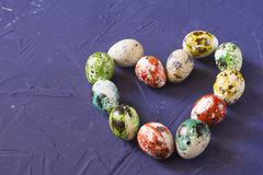Easter quail eggs heart. On blue background Stock Photos