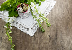 Easter quail eggs on a linen napkin, beautiful blossoms. Easter quail eggs on a linen napkin with  beautiful   white blossoms Royalty Free Stock Photography