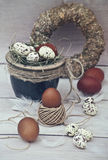 Easter quail eggs with white eggs in a pot royalty free stock photography