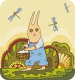Easter rabbit 1. Easter rabbit with eggs in a basket Royalty Free Stock Photos