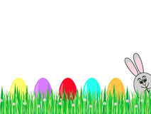 Easter rabbit. A row of colored Easter eggs on grass and Easter rabbit Stock Photography