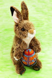 Easter rabbit. With the decorative egg from the beads Stock Images
