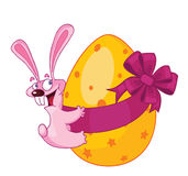 Easter rabbit. Cartoon pink rabbit with easter egg Stock Image