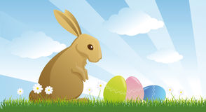 Easter rabbit. And eggs in the meadow Stock Photography