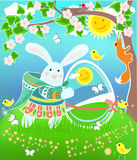 Easter rabbit. Beautiful decorated Easter rabbit with egg on spring background Royalty Free Stock Photos