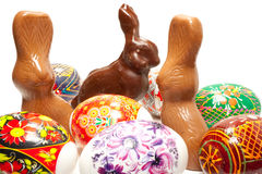 Easter rabbit. Chocolate easter rabbit in surroundings easter eggs Royalty Free Stock Photos