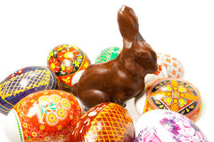 Easter rabbit. Chocolate easter rabbit in surroundings easter eggs Royalty Free Stock Photography
