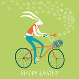 Easter rabbit on  bicycle with gift egg in basket. Vector illustration with cute Easter rabbit on  bicycle with gift egg in basket. Holiday illustration for your Stock Photography
