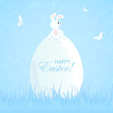 Easter rabbit and big egg. Blue Easter background with rabbit on the big egg in the grass, illustration vector illustration