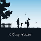 Easter rabbit and child on blue background Royalty Free Stock Photo