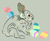 Easter rabbit with colored eggs Stock Image