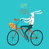 Easter rabbit cyclist illustration. Vector illustration with cute Easter rabbit on city bicycle with gift egg in basket Stock Images