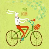 Easter rabbit cyclist illustration. Vector illustration with cute Easter rabbit on city bicycle with gift egg in basket Royalty Free Stock Photo