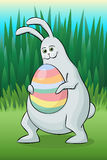 Easter rabbit with decorated egg Royalty Free Stock Images