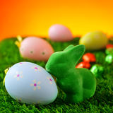 Easter rabbit and decorated eggs on the grass Stock Photos