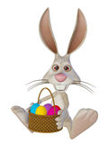 Easter rabbit with Easter eggs, sitting, isolated on the white Stock Photography