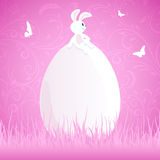 Easter rabbit on egg. Pink Easter background with rabbit on the big egg in the grass, illustration vector illustration