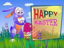 Easter rabbit with an egg. Is on the grass on a background of a spring landscape. Festive  cartoon illustration Royalty Free Stock Photo