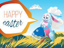 Easter rabbit with an egg. Is on the grass on a background of a spring landscape. Festive  cartoon illustration Stock Photo