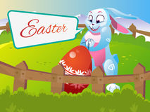 Easter rabbit with an egg. Is on the grass on a background of a spring landscape. Festive vector cartoon illustration Stock Image