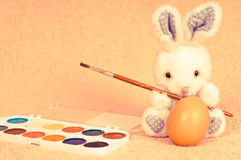 Easter rabbit with egg and paint Stock Photo