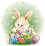 Easter Rabbit with Eggs. Cute Little Easter Rabbit with some Decorated Eggs Royalty Free Stock Photography