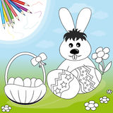Easter rabbit with eggs and basket stock image