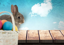 Easter rabbit with eggs basket in front of blue sky stock illustration