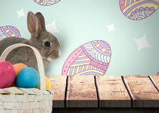 Easter rabbit with eggs basket in front of pattern. Digital composite of Easter rabbit with eggs basket in front of pattern Stock Images