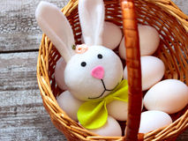 Easter rabbit and eggs in basket Stock Image