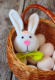 Easter rabbit and eggs in basket Stock Photo