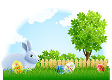 Easter rabbit and eggs on the green garden grass Stock Images