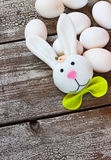 Easter rabbit and eggs on wooden table Stock Photos