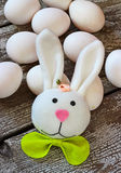 Easter rabbit and eggs on wooden table Royalty Free Stock Image
