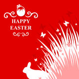 Easter rabbit in grass card. Vector illustrations of Easter rabbit in grass card on red background Royalty Free Stock Photo