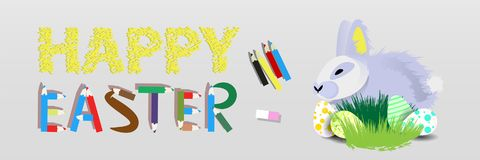 Easter. Easter rabbit in the grass with. Easter eggs on a gray background .. happy easter with pencils Royalty Free Stock Images