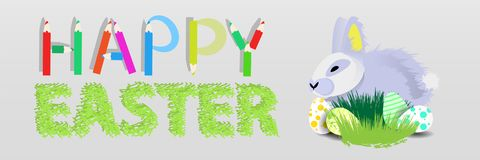 Easter. Easter rabbit in the grass. With Easter eggs on a gray background .. happy easter with pencils. horizontal sheet orientation Stock Photos
