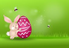 Easter rabbit on grassy background. Cute easter rabbit with easter egg on green grassy background Stock Image