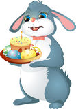Easter rabbit holds cake. Isolated on white background Royalty Free Stock Photos